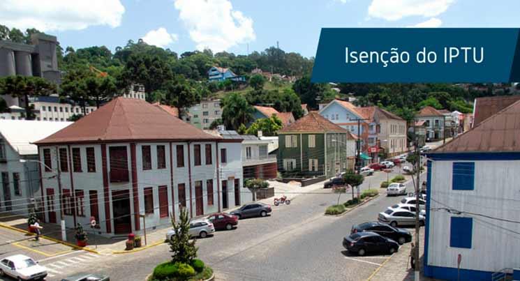"""Imagem de uma cidade com a frase """"Isenção do IPTU"""""""