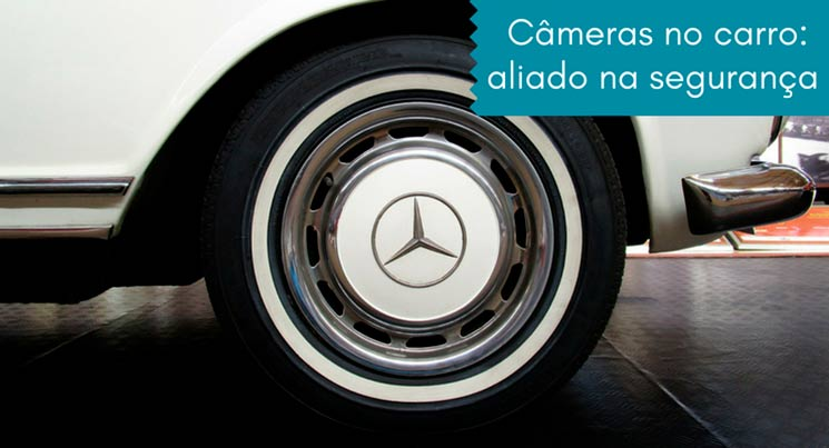 """Imagem de um pneu com a legenda """"cameras no carro: aliado na segurança"""""""