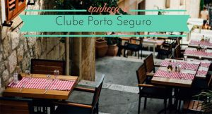 imagem de uma ladeira com mesas de restaurantes com a legenda: Conheça o clube porto seguro