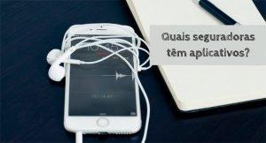 Imagem de um smartphone e um caderno em cima de uma mesa com a descrição: quais seguradoras tem aplicativos?