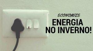 tomada na parede com os dizeres: economize energia no inverno