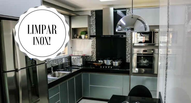 Imagem de cozinha com eletrodomésticos de inox. Escrito: limpar inox!