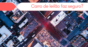 imagem de uma cidade vista por cima com a legenda: carro de leilão faz seguro?