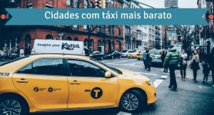 Imagem de uma cidade com um táxi na frente com legenda: cidades com táxi mais barato