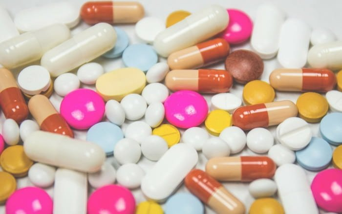 Imagem de pilulas para ilustrar post sobre plano de saúde individual