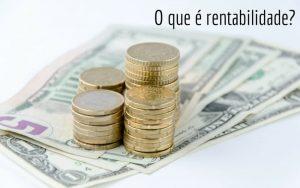 Imagem de notas e moedas com a legenda: O que é rentabilidade?