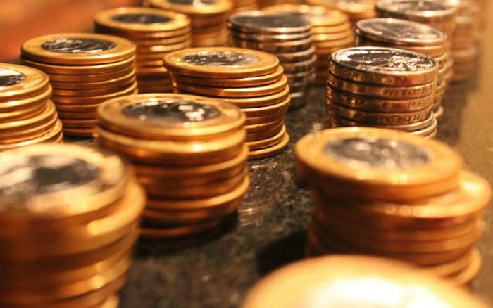 Imagem de moeda para ilustrar guia sobre investimentos renda fixa