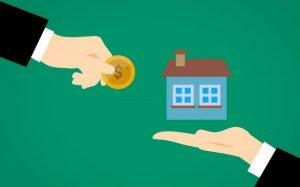 imagem de casa e dinheiro ilustrando texto sobre como declarar imóvel financiado