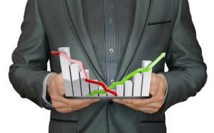 Imagem de gráficos ilustrando texto sobre como abrir uma conta para investir em ações