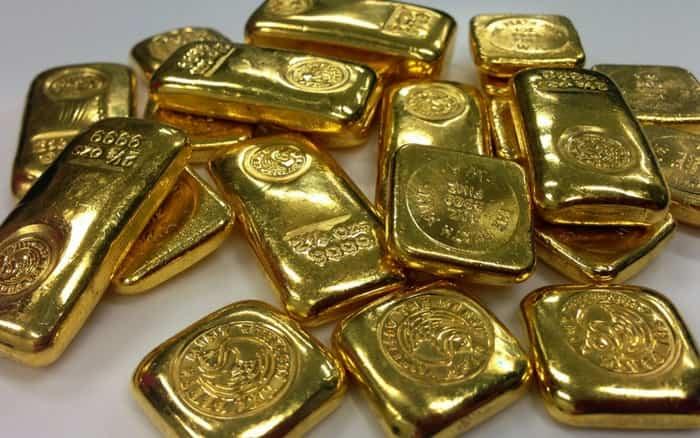 Imagens de barra de ouro para ilustrar post sobre como investir em ouro