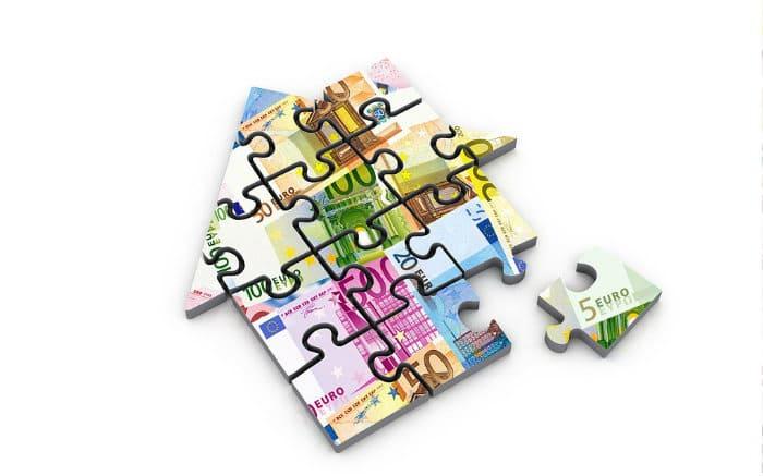 Ilustração de quebra cabeça de casa para ilustrar texto sobre empréstimo com garantia de imóvel