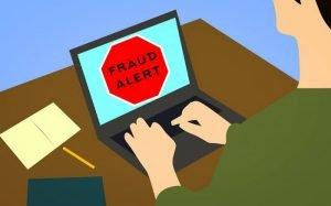 Imagem de computador indicando alerta para fraude para ilustrar texto sobre golpe do empréstimo