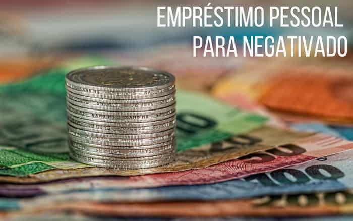 imagem de moeda e dinheiro de papel com a frase: empréstimo pessoal para negativado