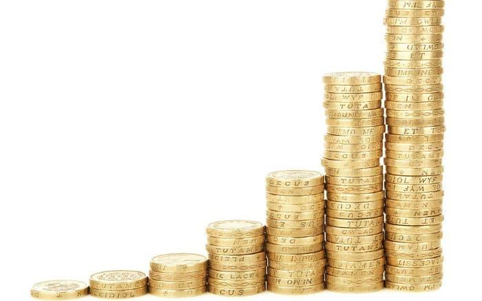 Imagem de moedas representando texto sobre fundo de reserva do consórcio