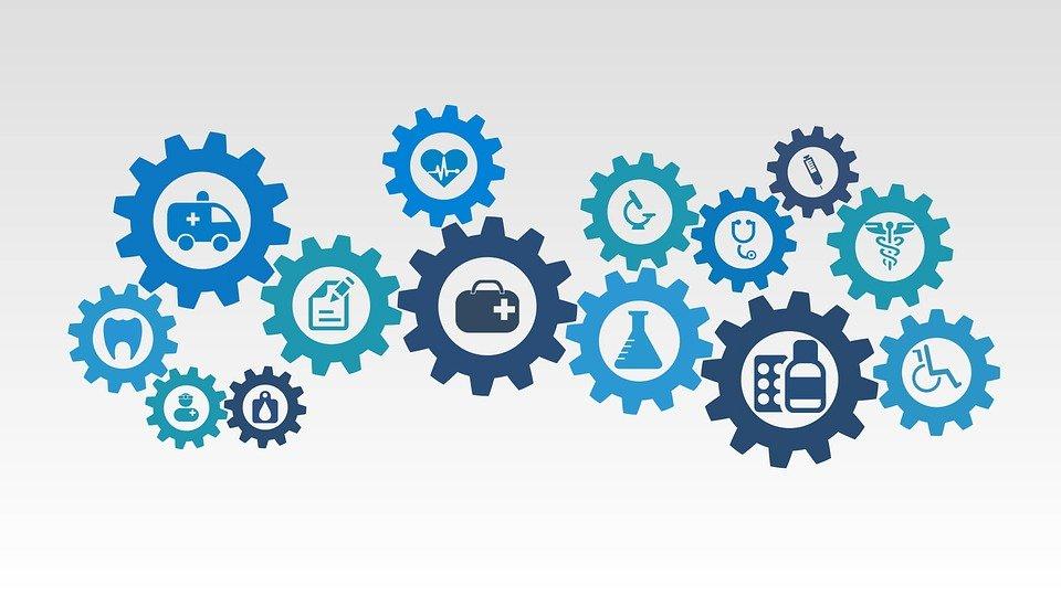 Imagem de engrenagens com ícones relacionados a área de saúde para ilustrar a postagem de como fazer plano de saúde