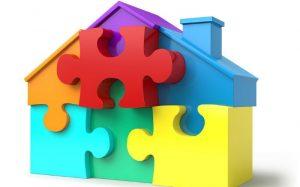desenho de casa em formato de quebra cabeça para ilustrar texto sobre como calcular seguro residencial
