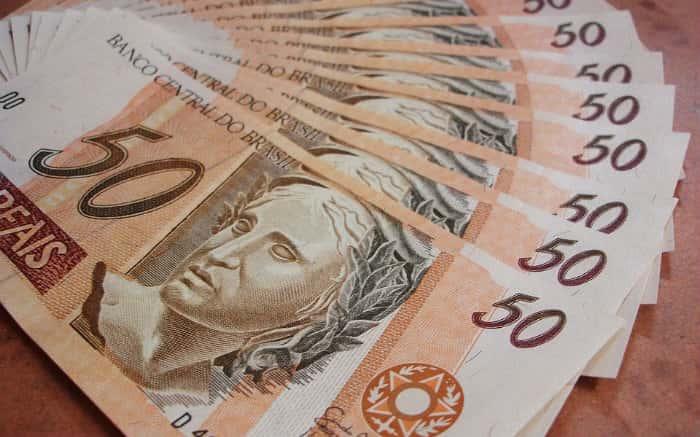 Imagem de dinheiro para texto sobre consulta FGTS inativo