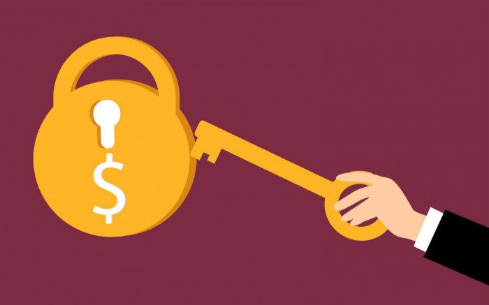 Imagem ilustrativa de chave e dinheiro para texto sobre seguro de vida com previdência
